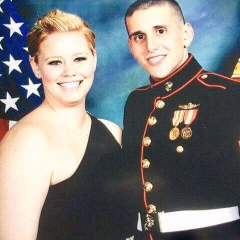 Nika pictured with her husband and marine.