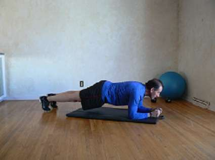 Demonstrating the front plank.