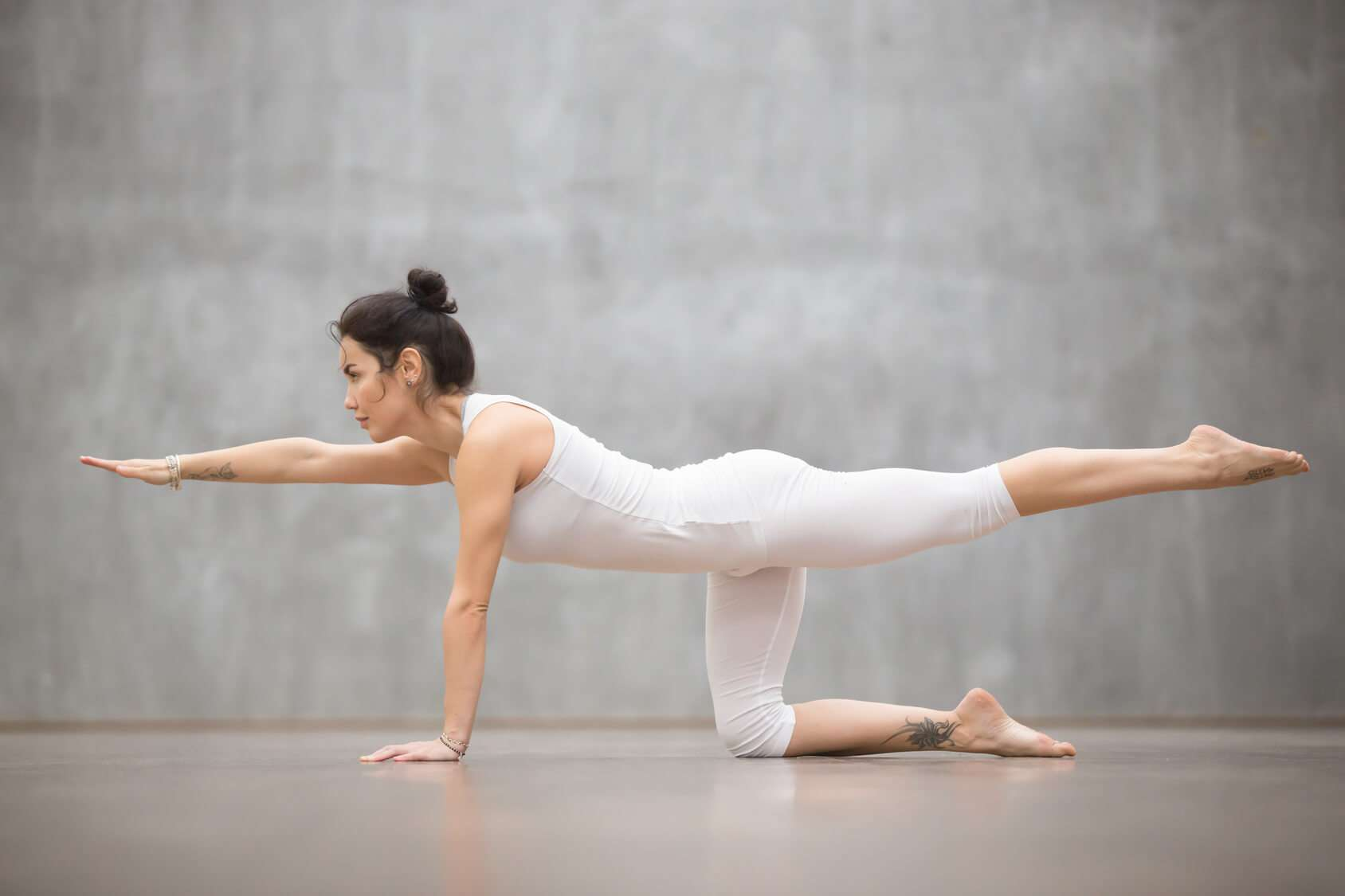 The bird dog yoga pose being performed can help stabilize the lower back.