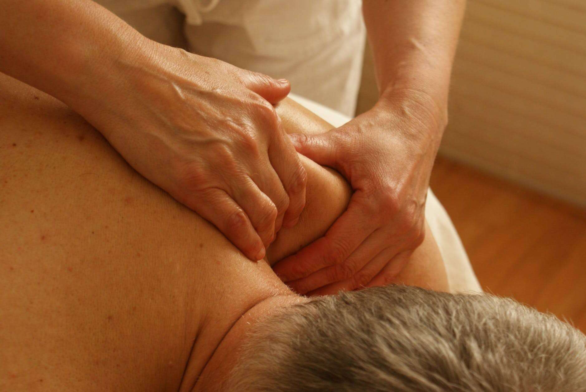 Receiving physical therapy to relieve spinal stenosis symptoms.