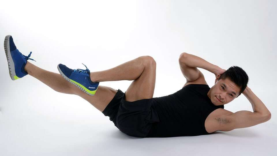 Man performing crunches, these can be dangerous if done too often.