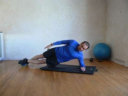 Demonstrating the side plank.
